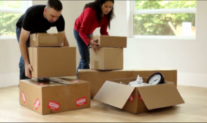 Couples Carrying Boxes